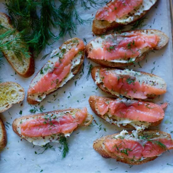 Smoked Salmon Toasts with Mustard Butter | Sour cream or cream cheese may be the usual spread with salty smoked salmon, but chef David Tanis thinks softened butter makes a tasty alternative. (Think of ham-and-butter sandwiches.) To give the butter a zippy bite, he stirs in lemon zest and both Dijon and grainy mustards.