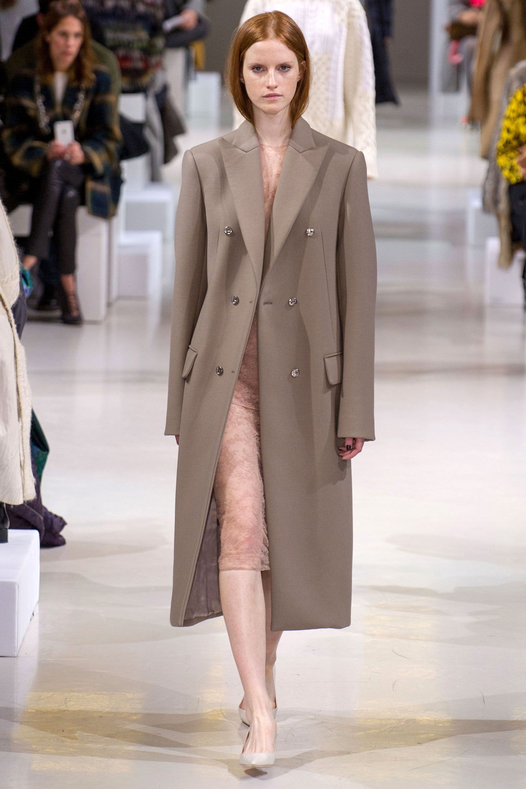 This was Henry's thesis on chic, sophisticated day dressing that merges with casual evening. Case in point: a navy t-shirt dress that was sheer or a taupe overcoat covering a pinky nude nothing of a dress.   - HarpersBAZAAR.com