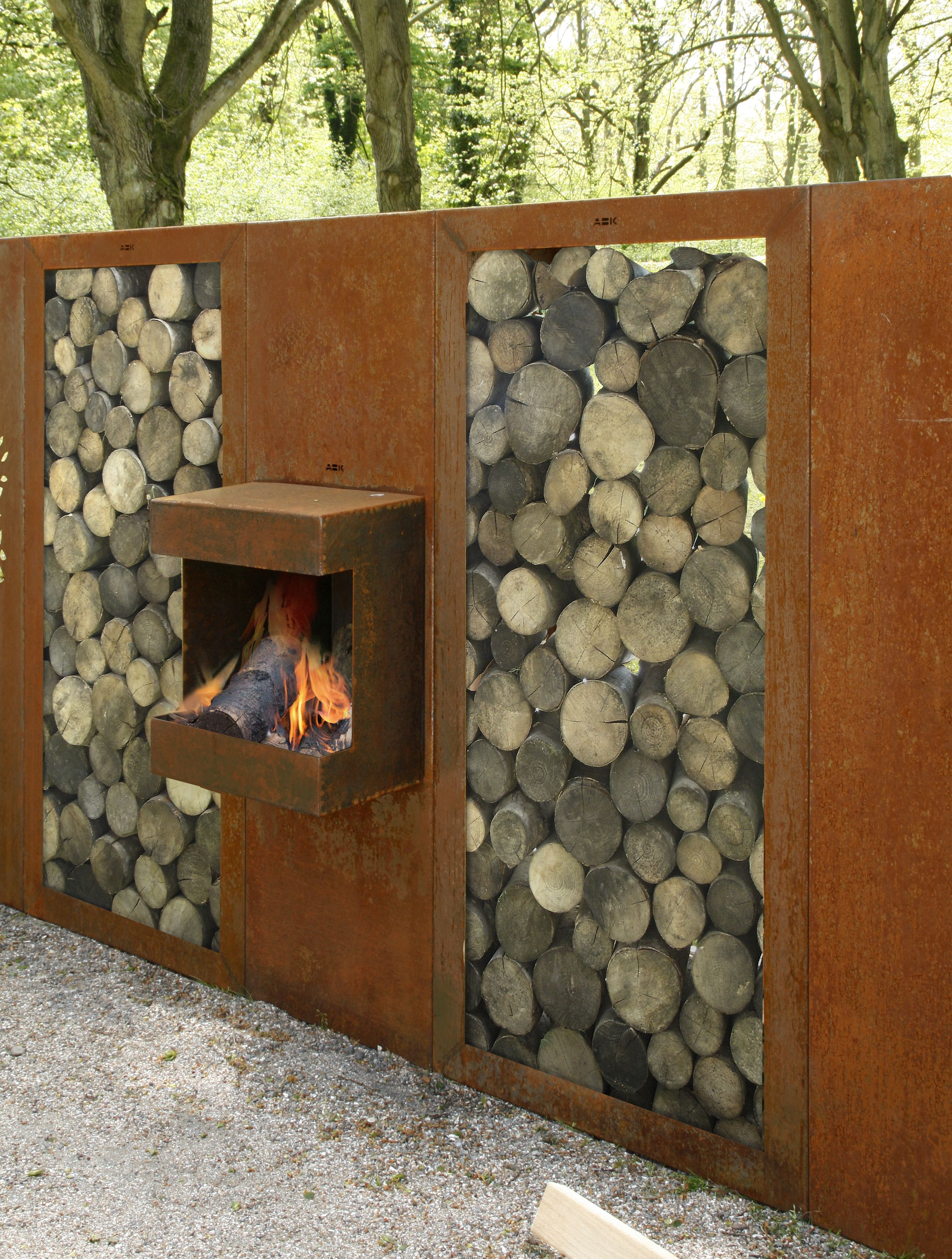 Corten steel fire place with wood storage abk for Mobilier jardin metal