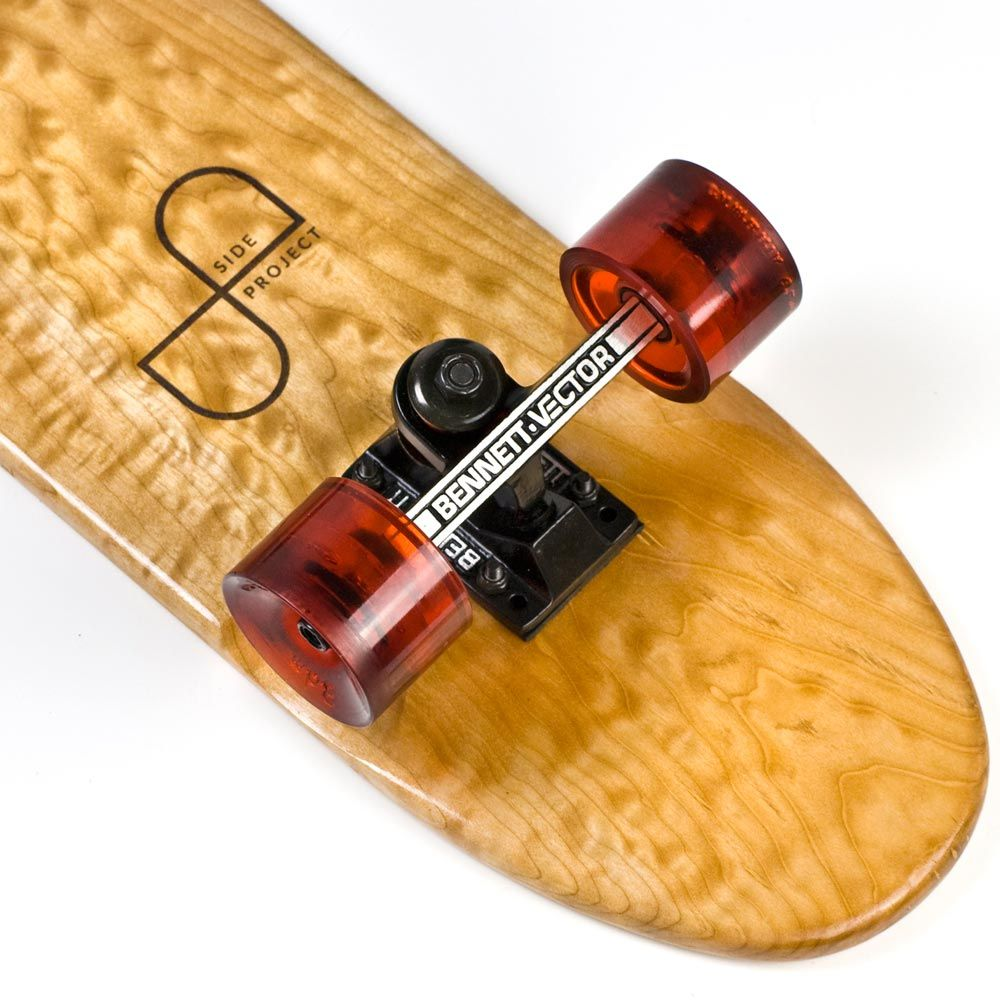 """The No. 7 is crafted from one of the strangest pieces of American Maple I've ever encountered. It features a rich, almost 'bubbly' grain pattern and a distinct amber cast. Vintage inspired profile with rounded edges and hand sanded wheel wells for added carving capability. Sealed with marine grade varnish.Handmade in Houston, Texas.American Maple30"""" x 7 1/8"""" x 5/8""""Bennett Vector 4.3"""" TrucksSeismic 3dm Cambria Wheels (62mm // 80a)Tekton 6-ball be..."""