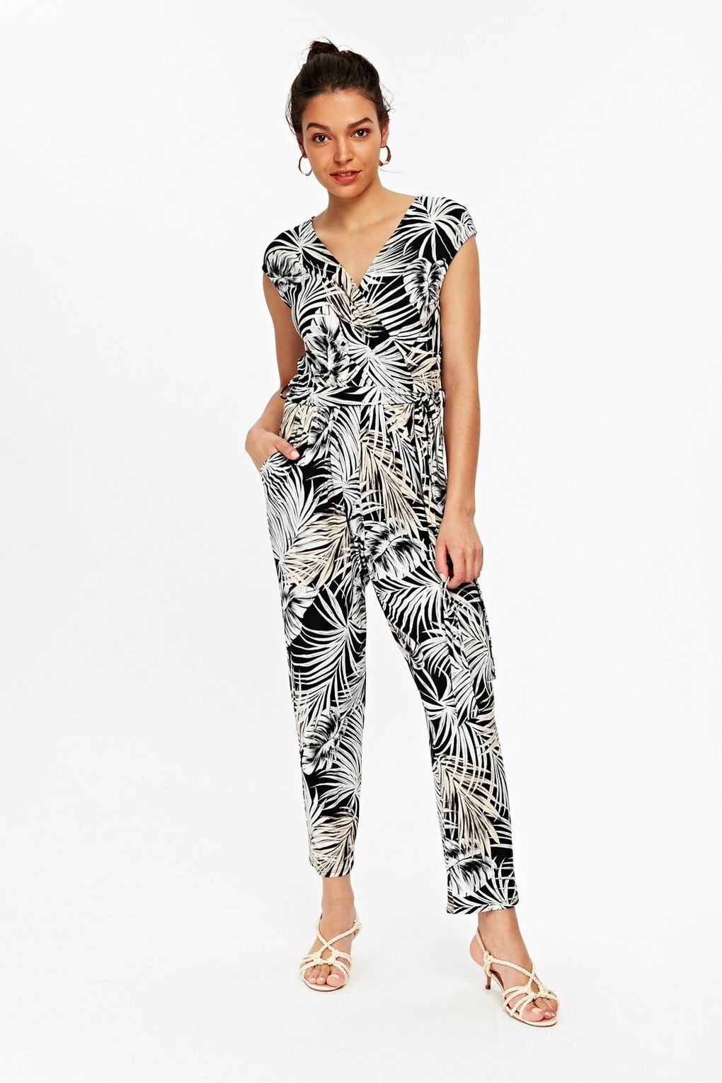 34521e8ac3f5 This figure flattering jumpsuit is perfect for summer and can be worn day  to night