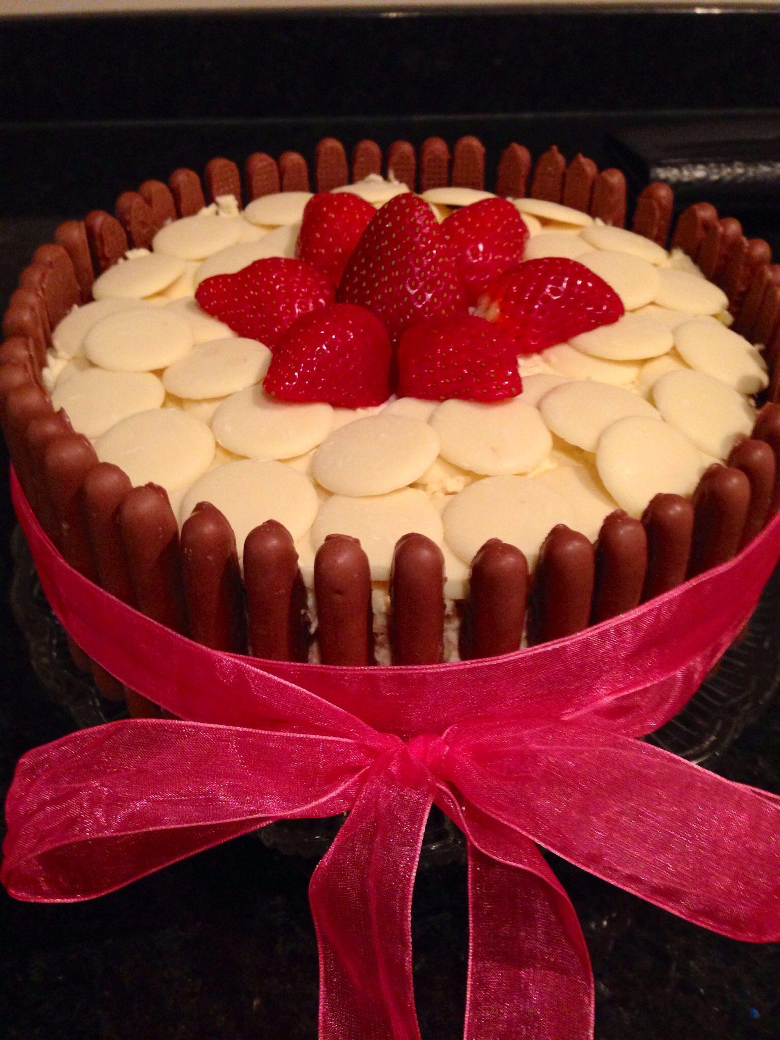 Chocolate fingers, White Buttons, Cream  Strawberries! Celebration Cake.   I actually make this to bring into school for all of the staff on my last day.