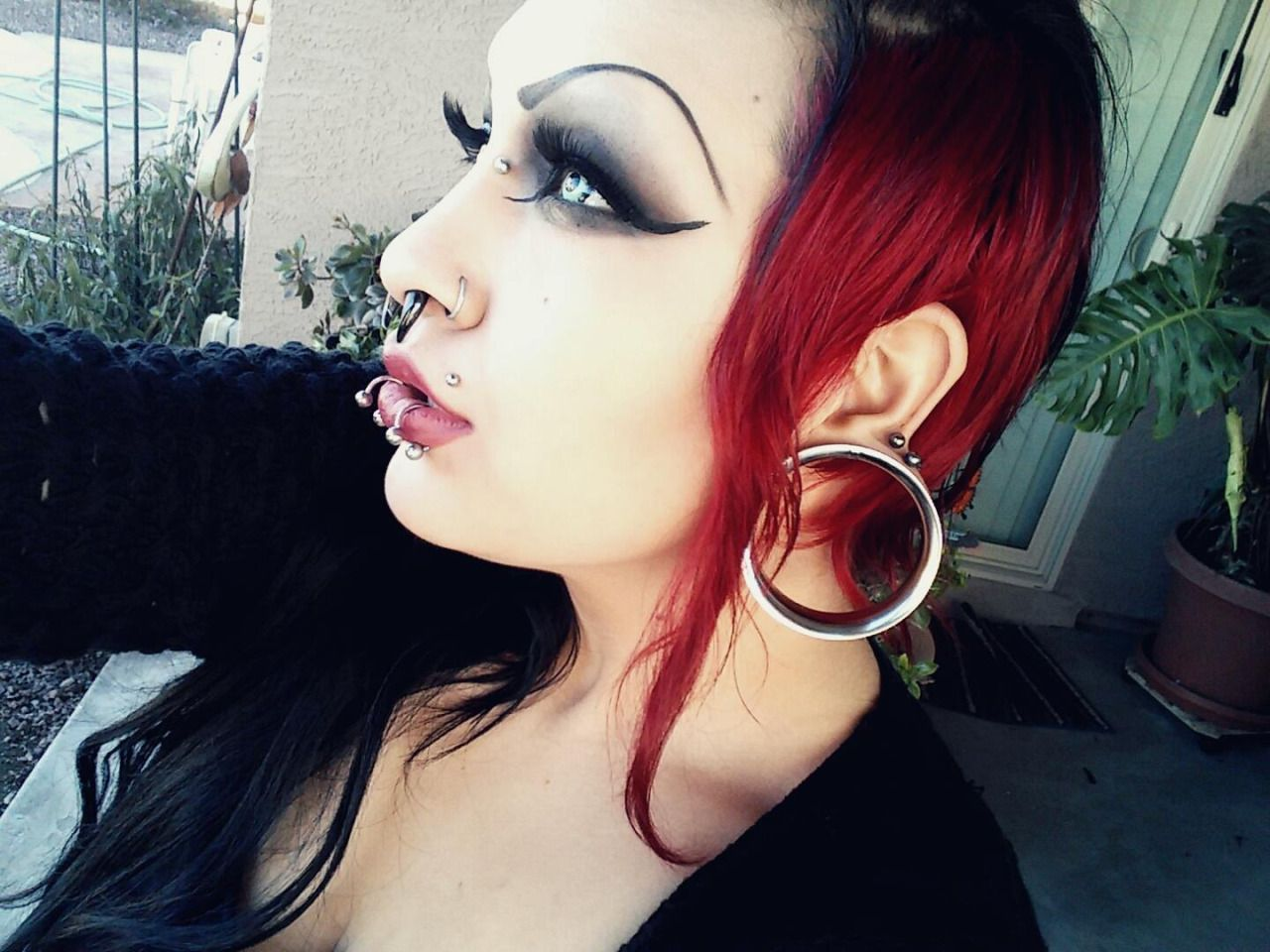 Double nose piercing and septum  Women with huge septums  Photo  Bodymodification  Pinterest