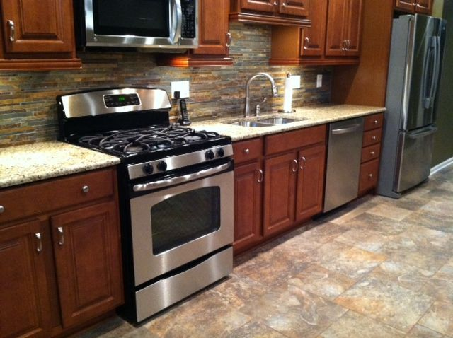 New Kitchen With Merrillat Cherry Stained Maple Wood Cabinets, Granite  Counter Tops, Slate Backsplash And Ceramic Tile Floor. Located In Hudson,  Ohio.