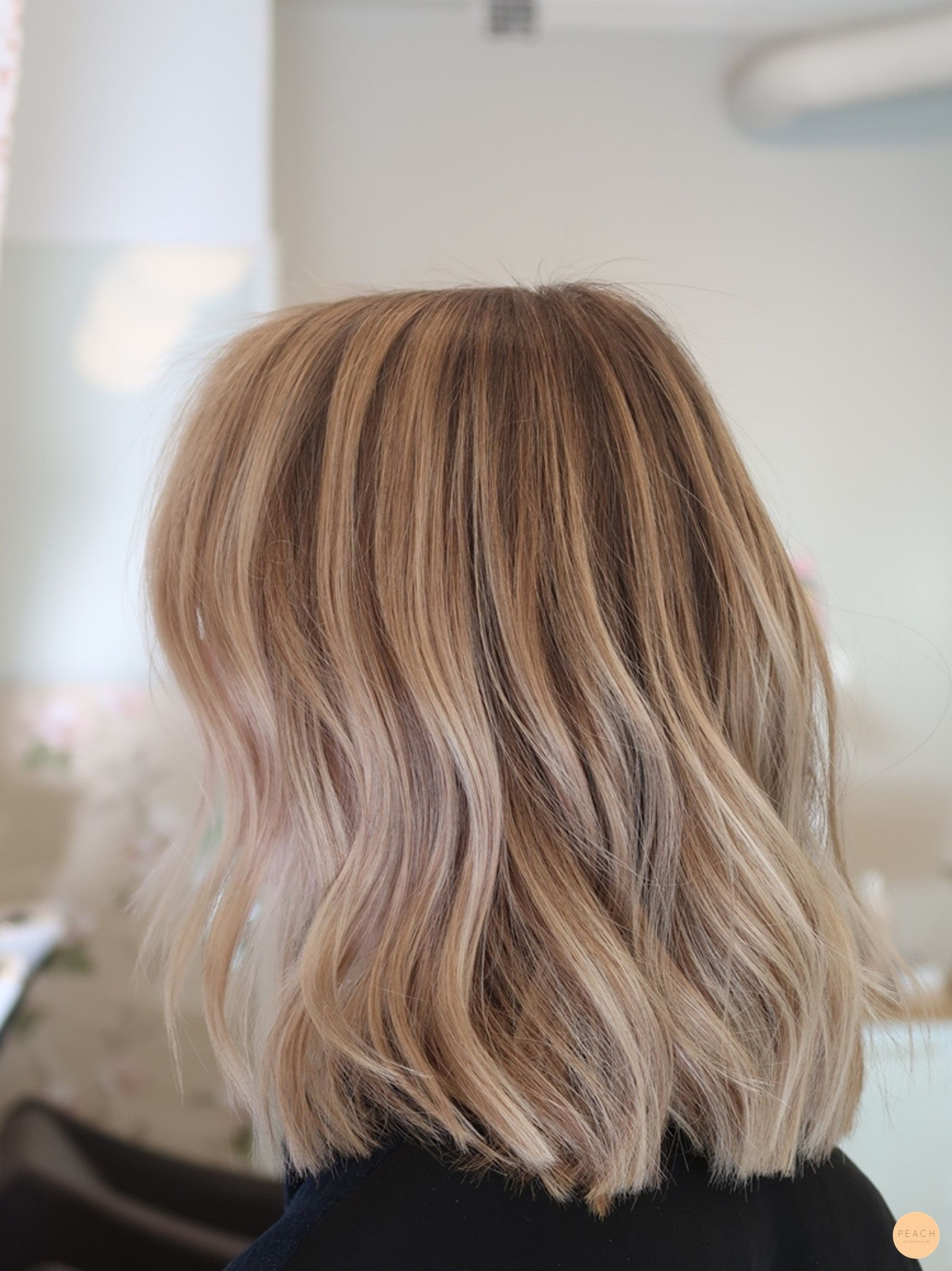 Photo of Balayage in a blonde hair – Peach Stockholm
