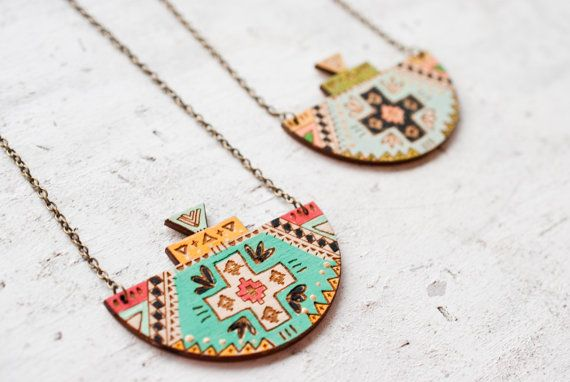 Tribal style pendant necklaces designed and handpainted by me! The design is lasercut on wood and handpainted. Pendants measures 2.75 inches wide and