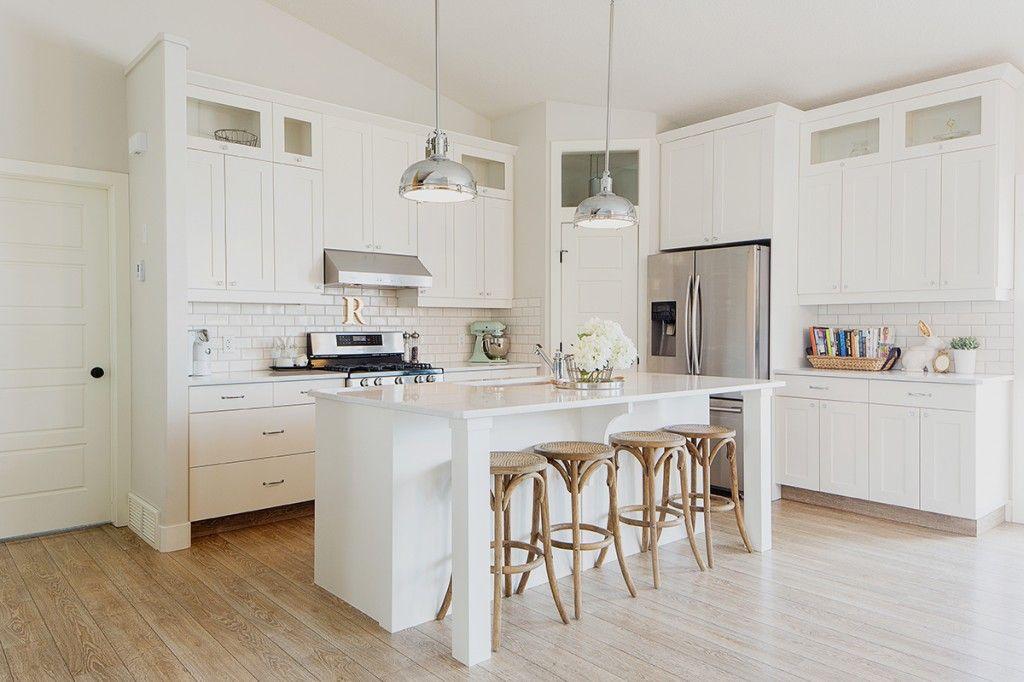 White kitchen, island legs, bar stools, chrome pendants ...