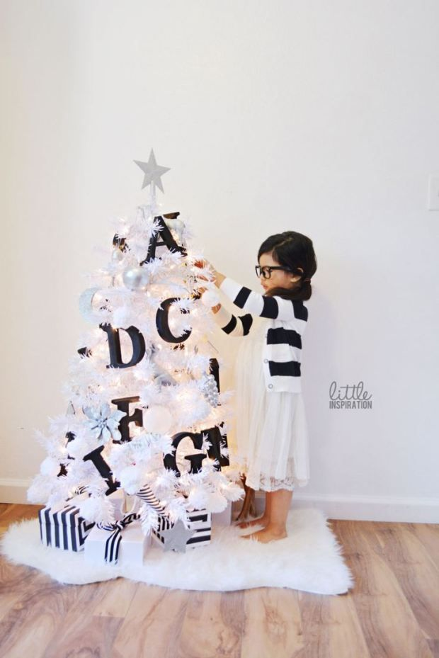 A Small White Christmas Tree For Kids With Black And White Alphabet