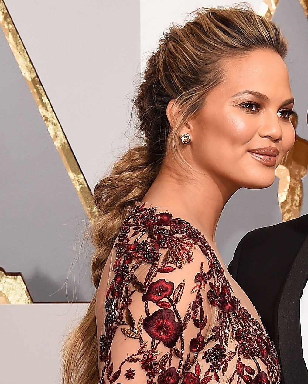Chrissy teigen looks gorgeous in this messy textured braid with lots