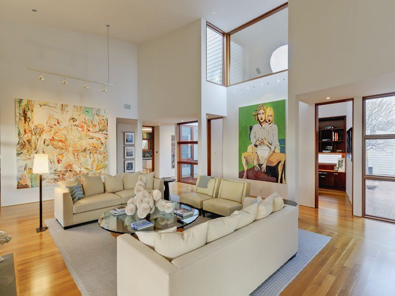 the home has high ceilings and lets in a lot of light How to Decorate Interiors With High Ceilings