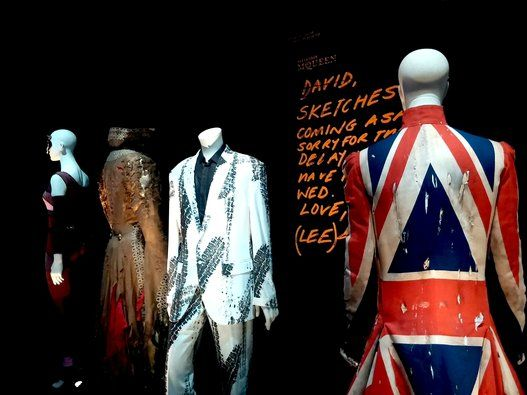 "Alexander McQueen's Union Jack coat creation for Bowie (right). The coat was worn on the cover of Bowie's 1997 ""Earthlings"" album."