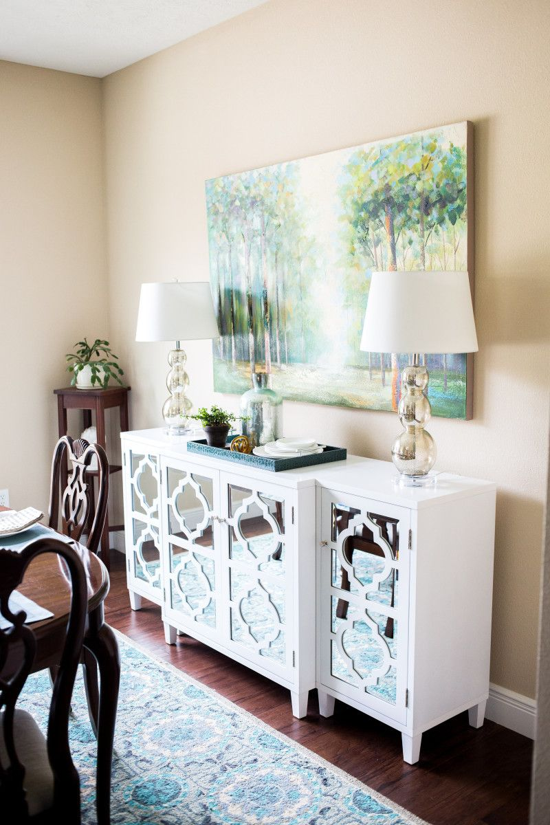 Awesome Dining Room Sideboard Decorating Ideas Part - 12: In A Dining Room, Flank A Buffet With Two Lamps And An Oversized Piece Of  Artwork For A Dramatic Statement. (Click Through For Lots More Tips To  Decorate An ...