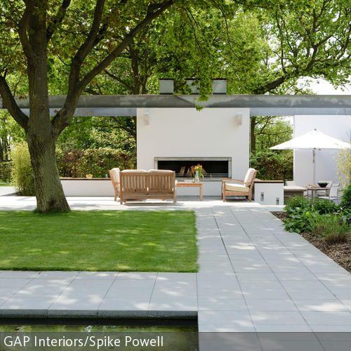 Terrasse mit Steinplatten und Rasenflächen moderne Terrasse - moderner vorgarten mit kies