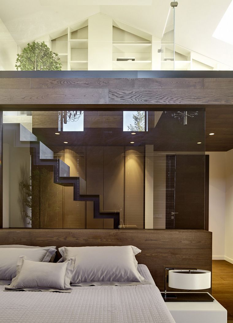The Interior Of The Two Level Bedroom In A Private Home House