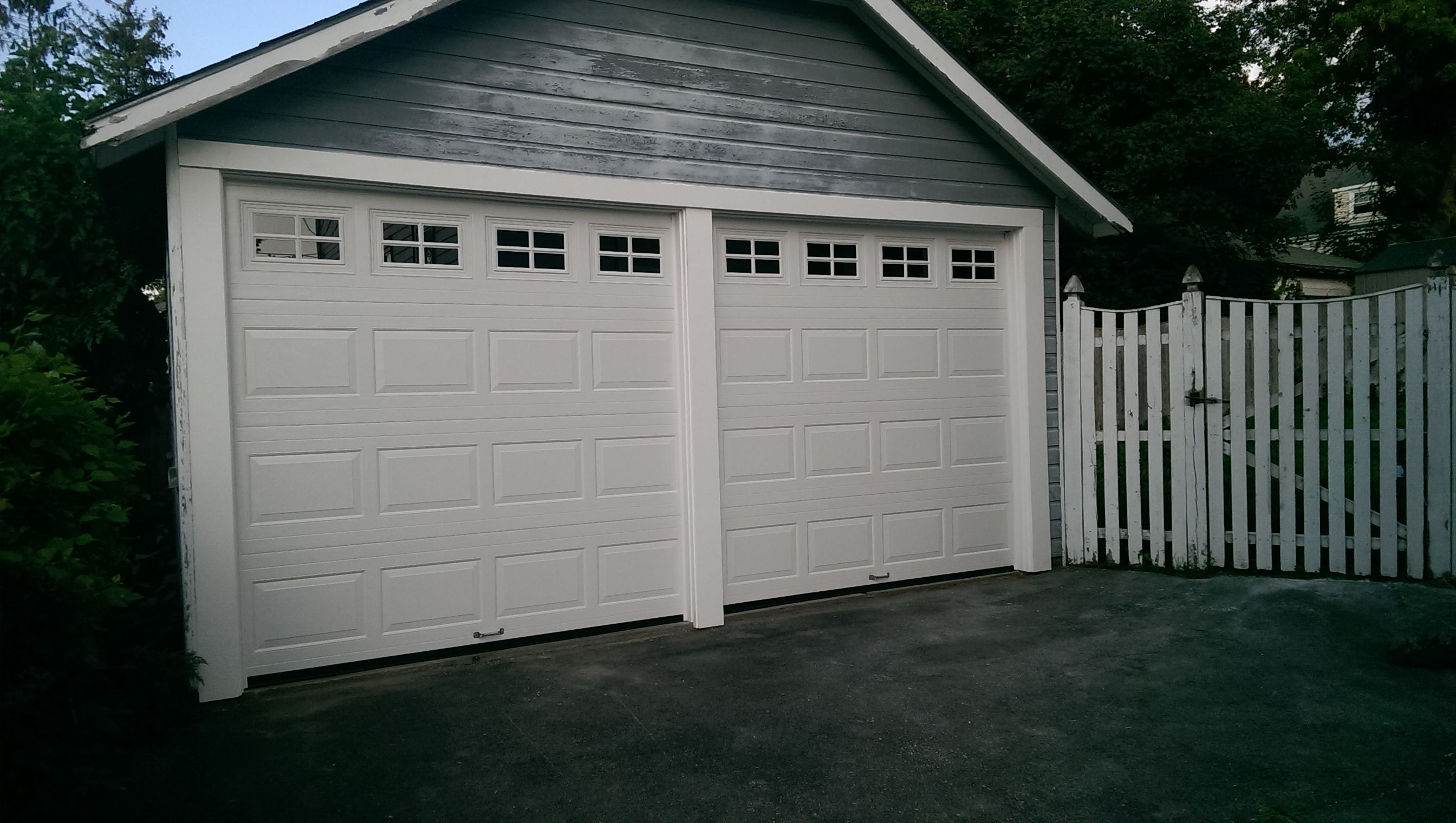 Haas Model 680 Raised Panel Steel Insulated Garage Doors In White With Colonial Glass Installed By Mort Garage Door Styles Garage Door Insulation Garage Doors