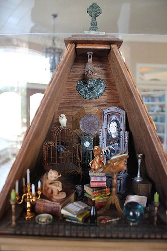 Haunted dollhouse like the book stacks and creepy birdcage