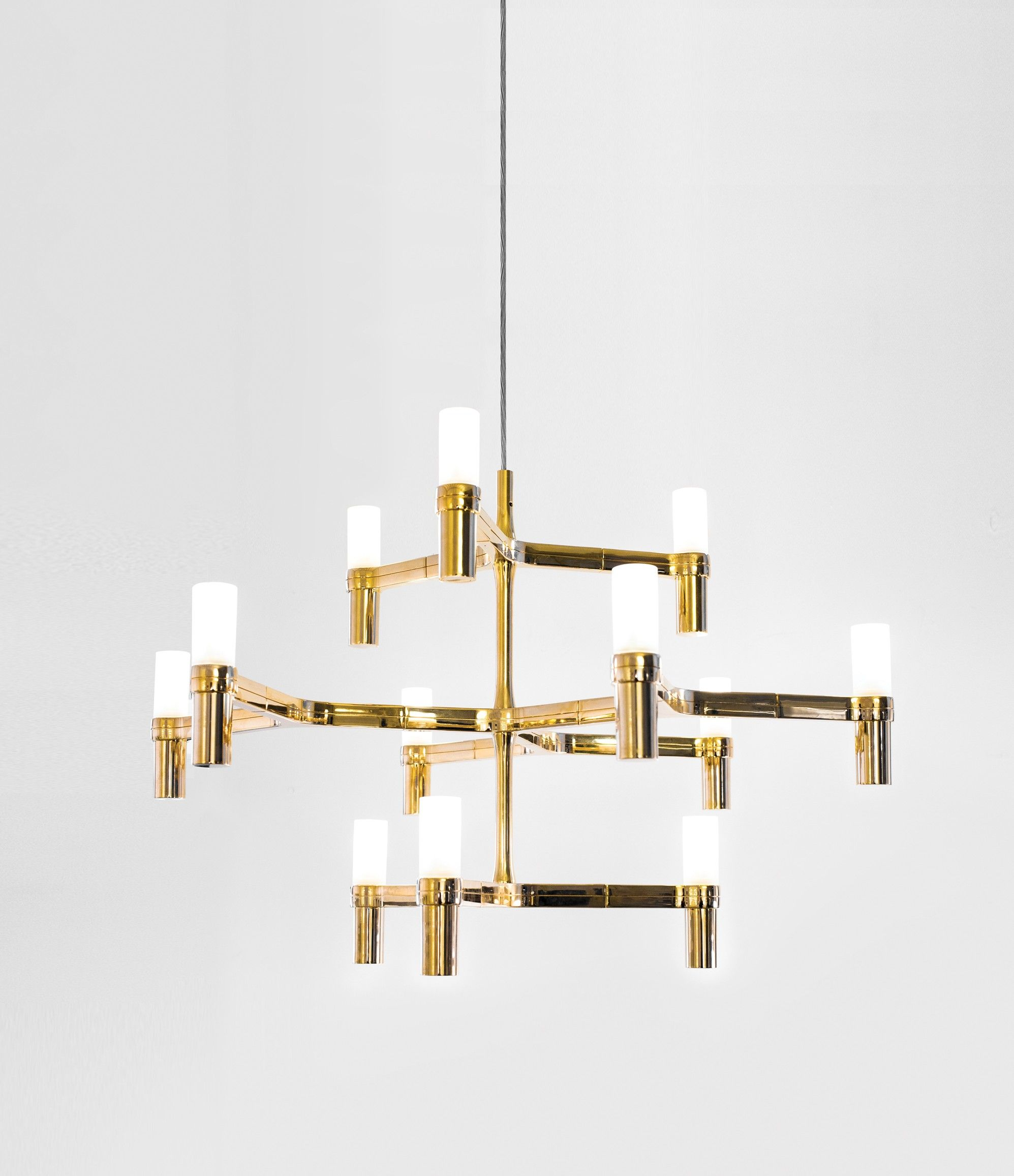 CROWN MINOR Pendant chandeliers, with modular structure in die-casted aluminium and sandblasted glass diffusers. Structure glossy polished, painted in white, matt black or gold. Available a NEMO LED G9 kit for a warm tone. Widespread light. Double switch for versions with more than a level. Transparent cable on all the versions.