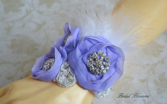 This is a beautiful triple flower wrist corsage. Flowers are made from chiffon fabric and embellished with silver leaves, sparkly