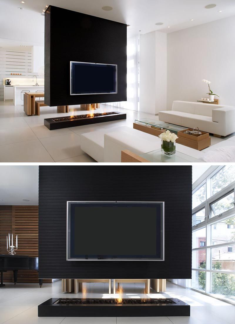 This Room Divider Is A Suspended Wall That Also Includes A Fireplace And Tv Living Room Partition Design Modern Room Divider Room Partition Designs