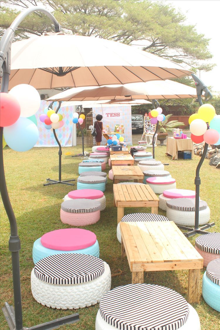 painted tires with cushions for outdoor seating