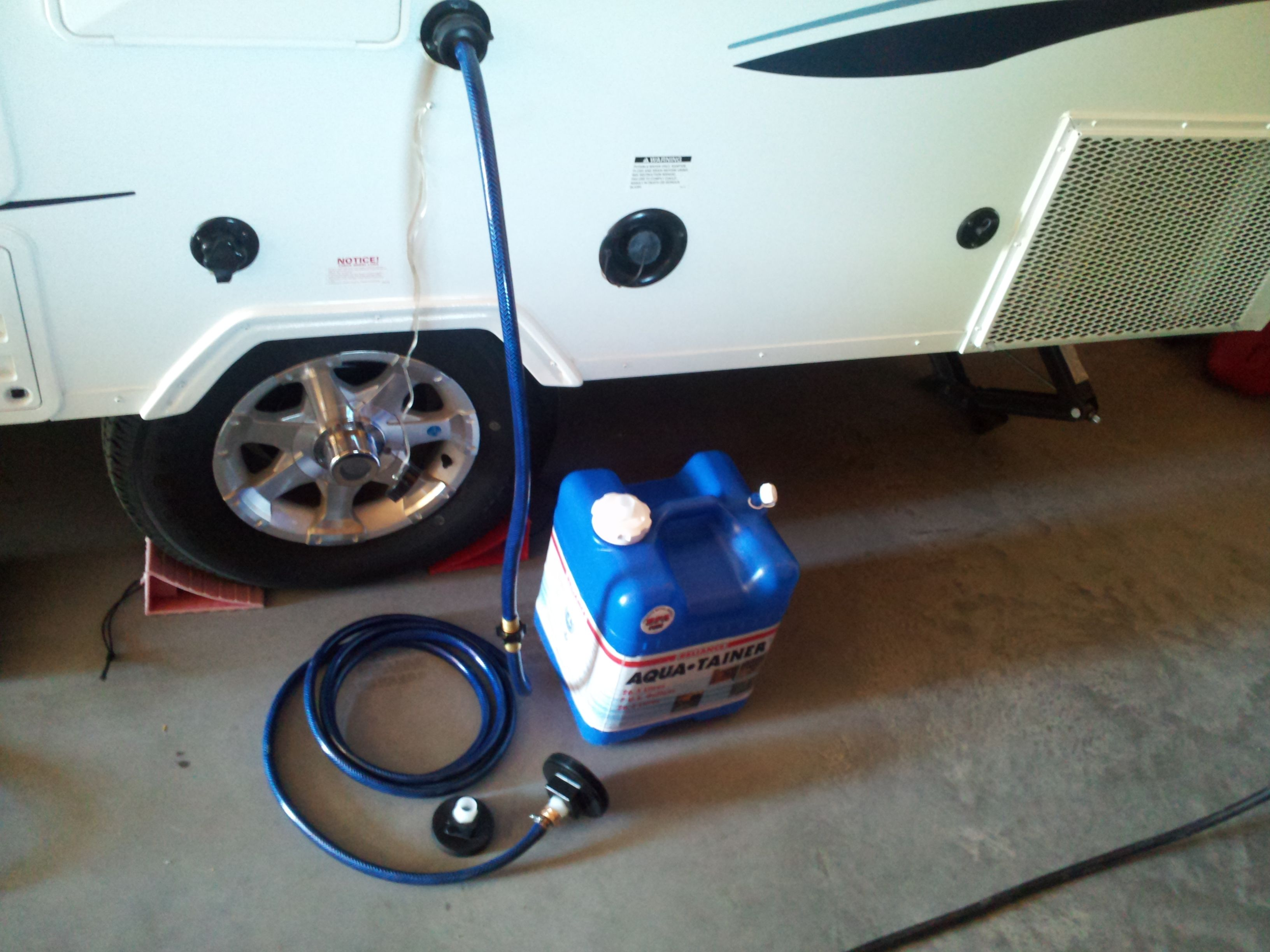 Grey water kit for the aframe trailer uses a short hose