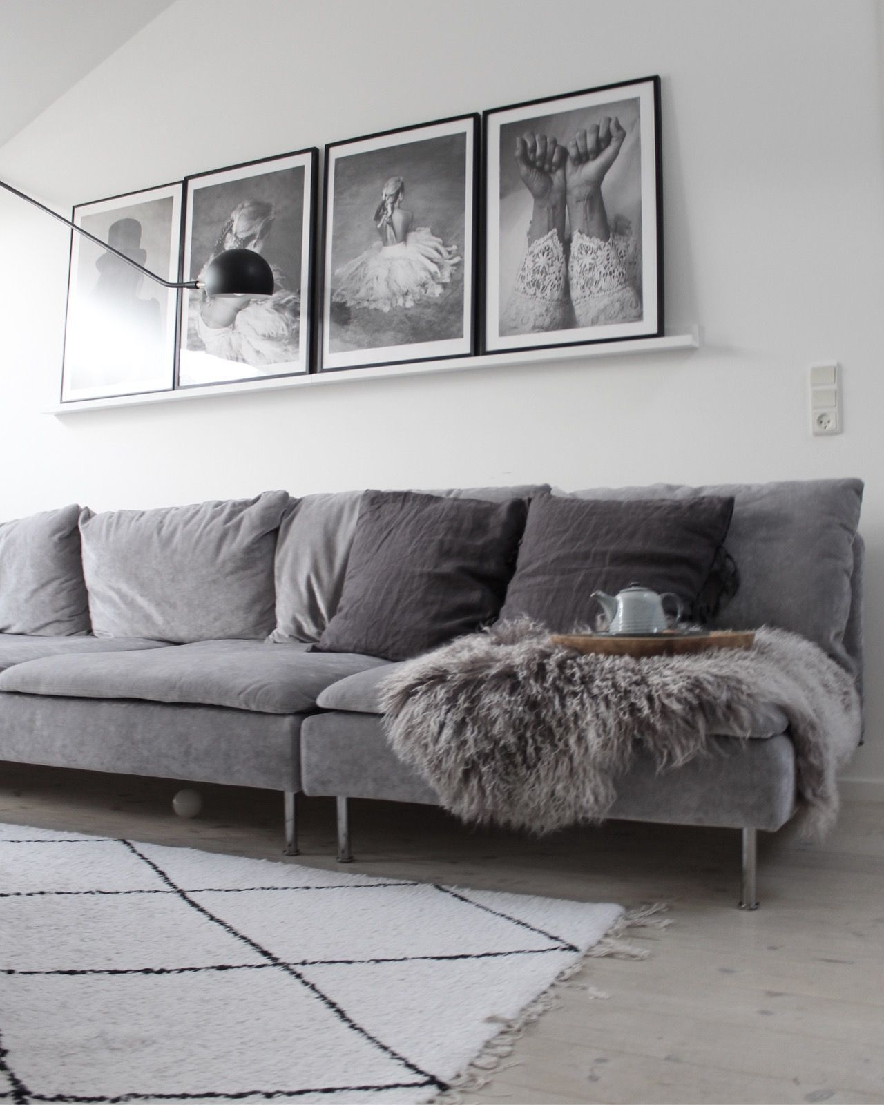 Cool Scandinavian Inspired Living Room With A Grey Velvet Sofa Black And White Photo Art Be Living Room Scandinavian Grey Velvet Sofa Living Room Rugs Ikea