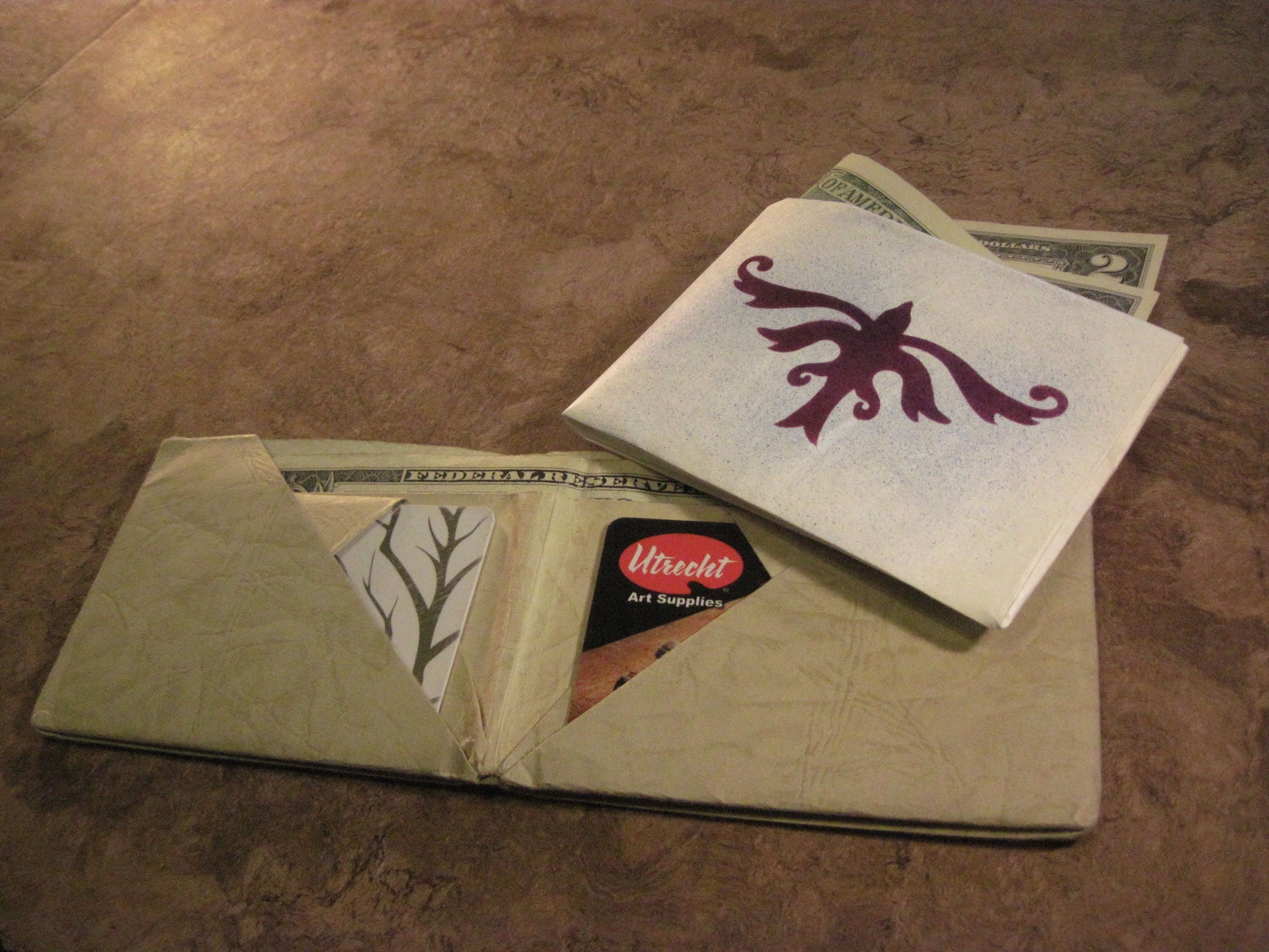 Fold an awesome wallet from a sheet of paper (15.5 in x 13 in). Used ...