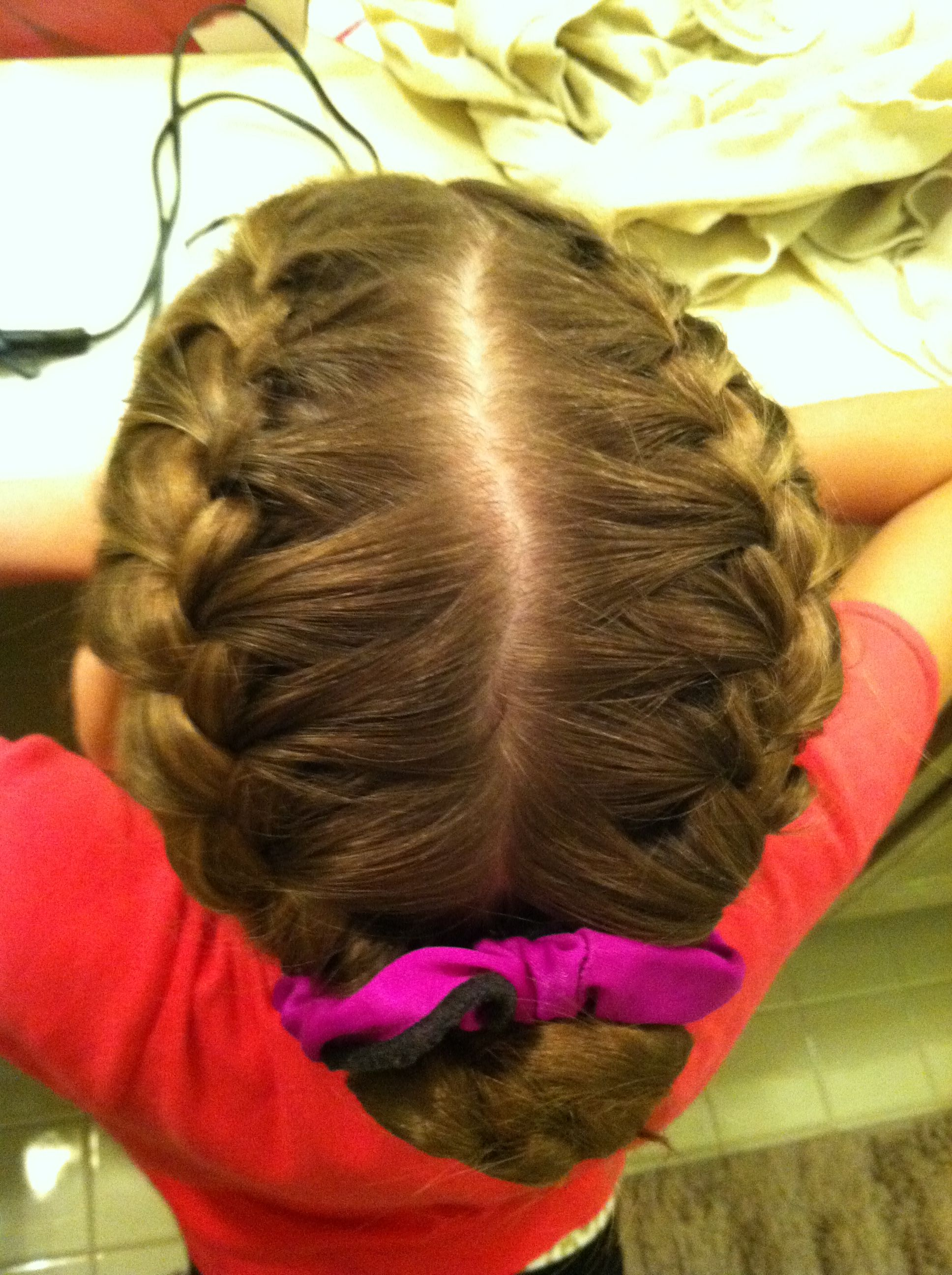 two french braids into a bun. common dance/figure skating