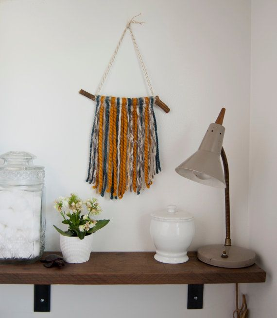 Wall Hanging  Yarn Art  The Matilda  Yarn Wall by MyGoldenSparrow  This wall hanging is a combination of navy blue, burnt orange, cream and textures. The tapestry hangs from a unique shaped branch that has been hand sanded and oiled to create this one of a kind piece.