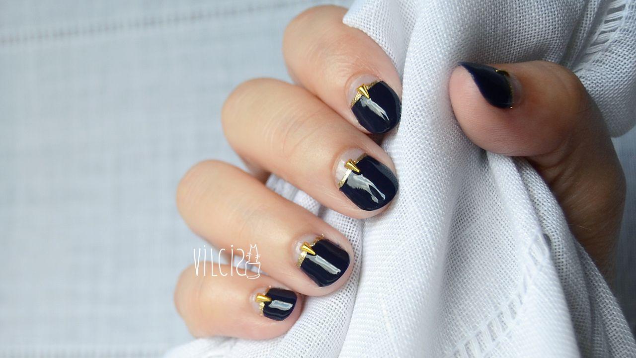 Elegant and chic nail design with dark blue and gold nail polish and ...