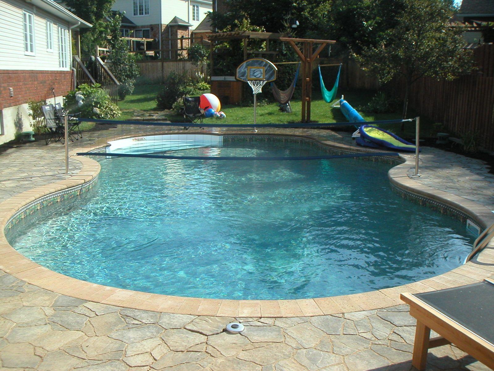 18x36 Lagoona Inground Pool With Custom Volleyball Net And 11ft Roman Step Inground Swimming