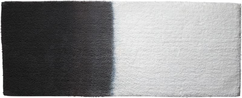 fade to black. Hand dip-dyed by artisans in India, this ultra-plush cotton runner steps up the bath with an ombre gradation that shifts from white to black. 100% cottonHand dip-dyed with reactive dyes; each will be uniqueMachine washMade in India.
