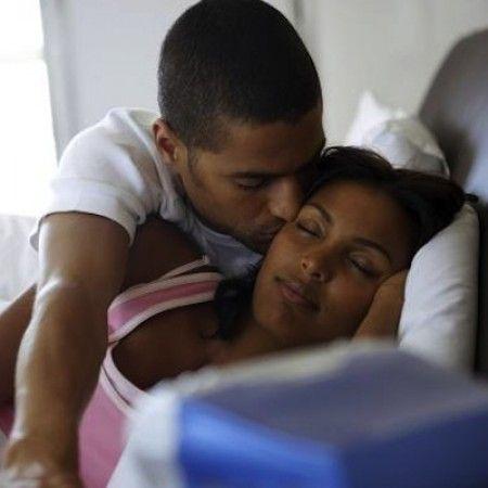 kissing Black woman
