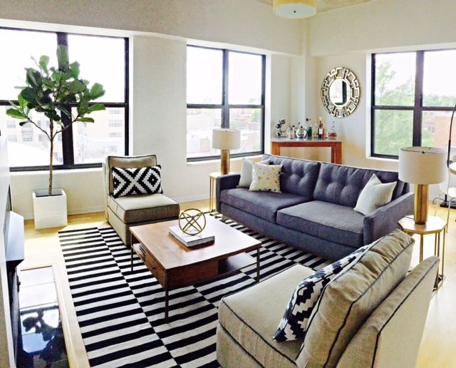 This Bright Corner Unit For Rent In Edgewater Has An Open Floor Plan That Maximizes Natural Light Pine Wood Bohemian Living Rooms Home Beautiful Living Rooms