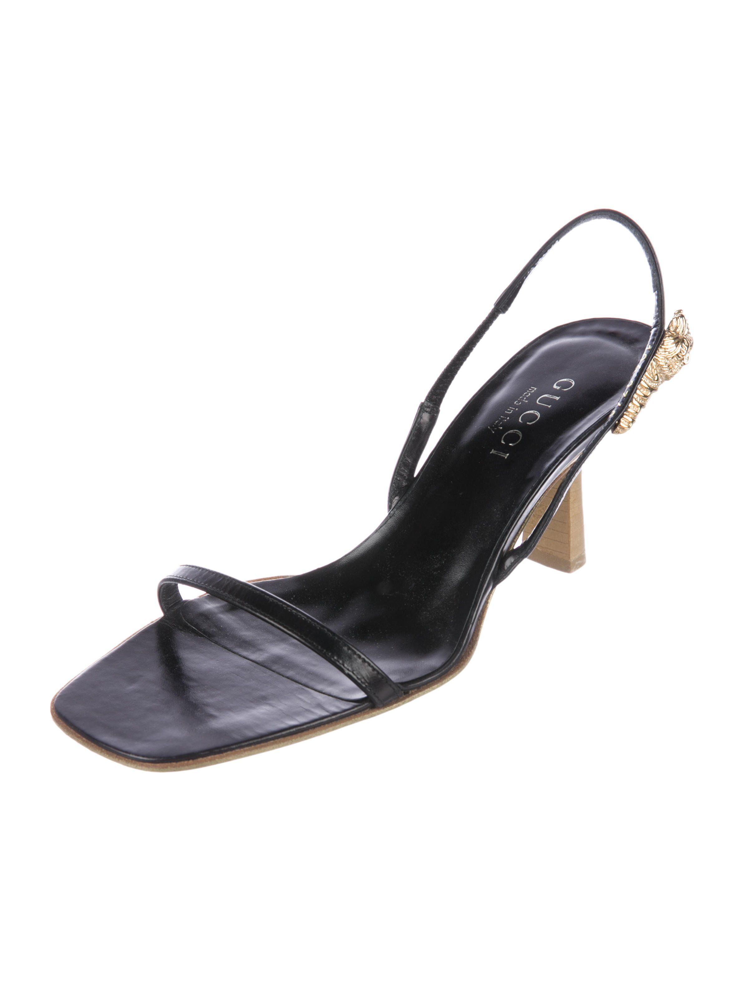 c367ea0e773d Black leather Gucci slingback sandals with tonal stitching and stacked  heels. Includes box.