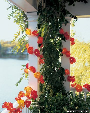 Silk-Flower Party Lights- just regular Christmas lights covered with silk flowers