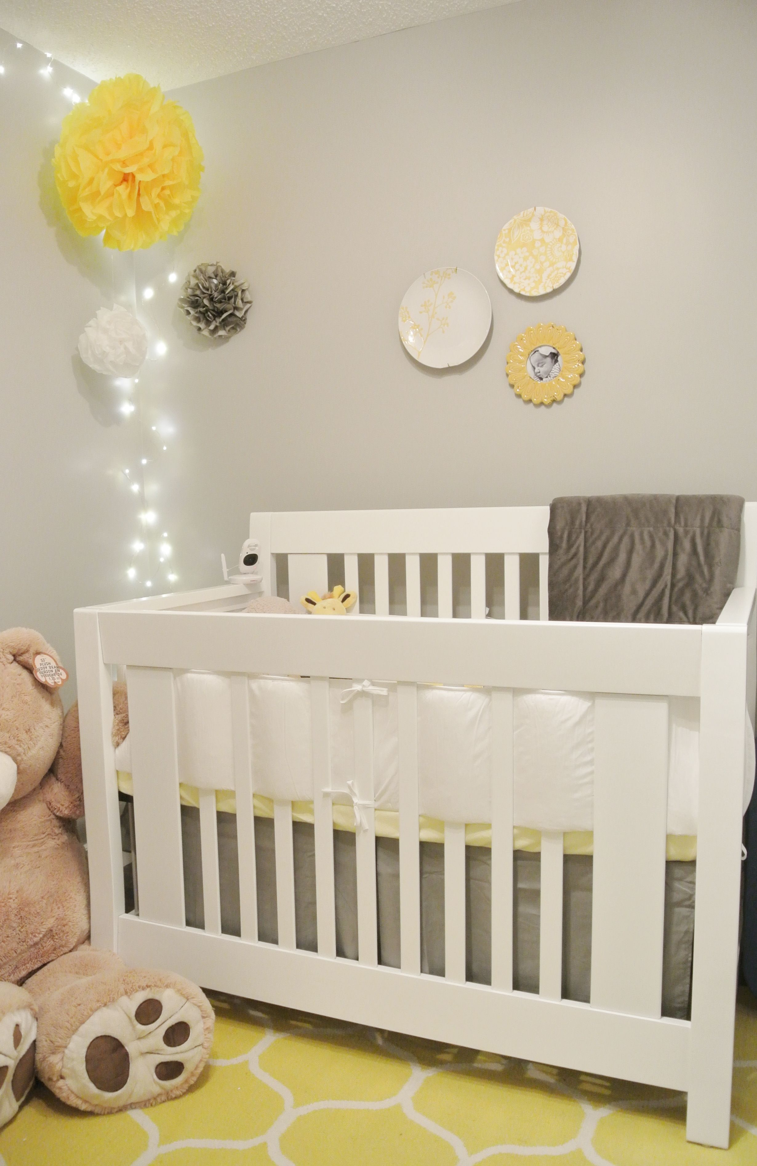 White crib in Grey & Yellow baby's room