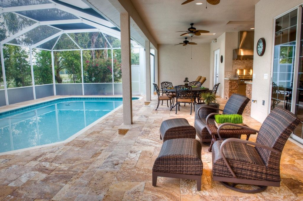 Tropical patio with exterior stone floors screen for Outdoor pool room ideas