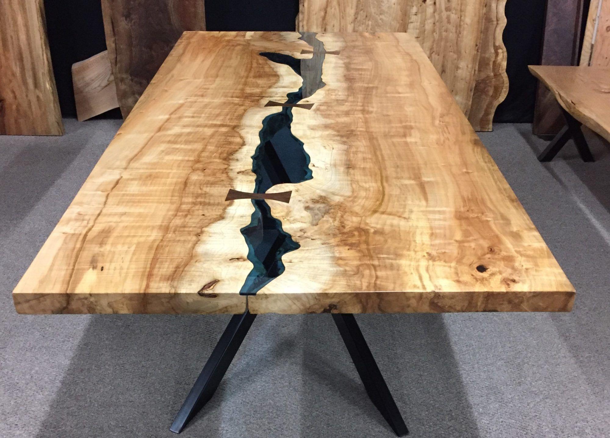 Our expert craftsmen build custom designed solid wood furniture from