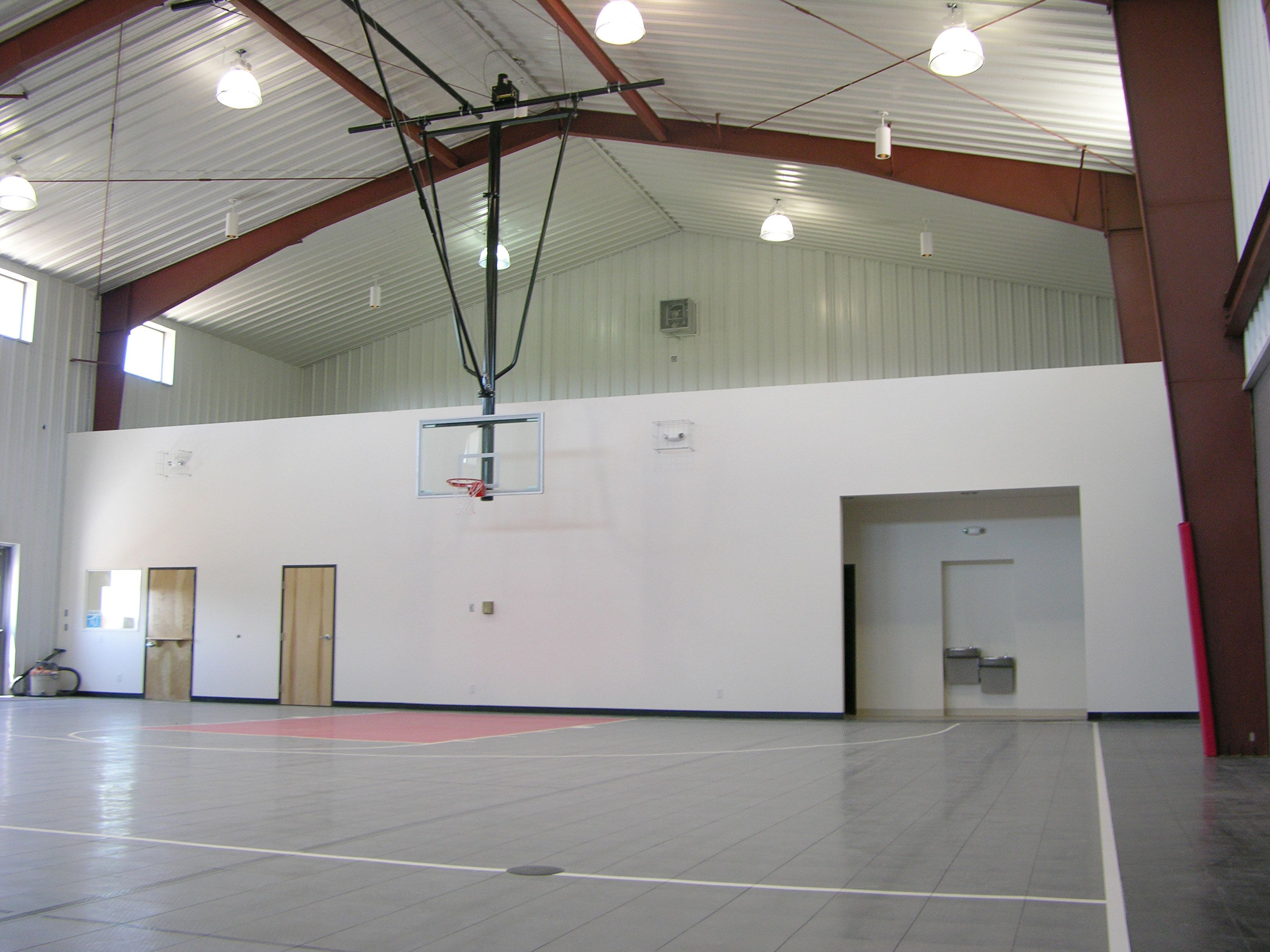 Metal Building Gymnasiums Steelgyms Gymbuildings Metalbuilding 1 800 292 0111 Https Www Metalbu Indoor Basketball Court Indoor Basketball Metal Barn Homes