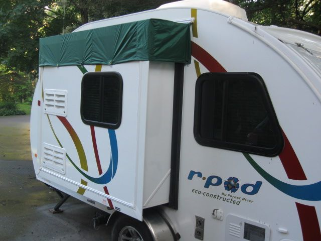 Channel over slide out? | Pod camper, Camper storage ideas ...