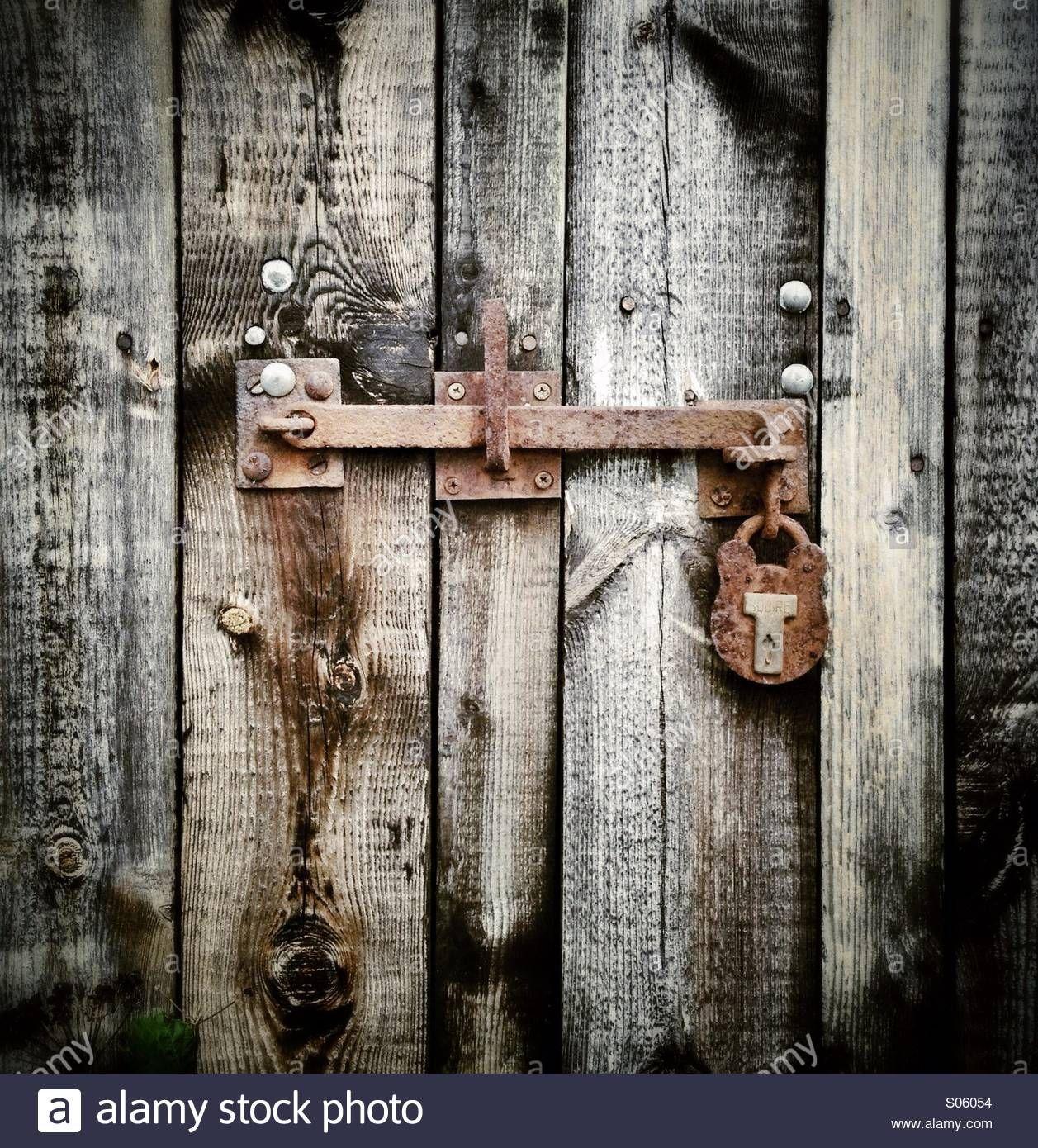Rusty Bolt And Padlock On An Old Barn Door Stock Photo Old Barn Doors Barn Door Barn Door Locks