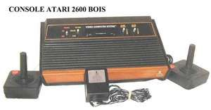 ATARI  we got our first one Christmas morning 1983 with tons of games and played it nonstop.