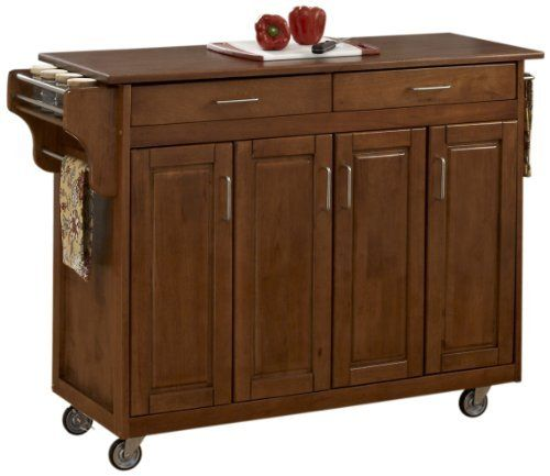 Home Styles 9200-1066G Create-a-Cart, Warm Oak Finish with Oak Top by Home Styles. $348.49. Four cabinet doors that open to storage with three adjustable shelves inside. Heavy duty locking rubber casters for easy mobility and safety. Handy spice rack with towel bar and paper towel holder. 3/4-inch oak finished wood top. Home Styles Create-a-cart in a cottage oak finish with a 3/4-inch oak finished wood top features solid wood construction, four cabinet doors that open to...