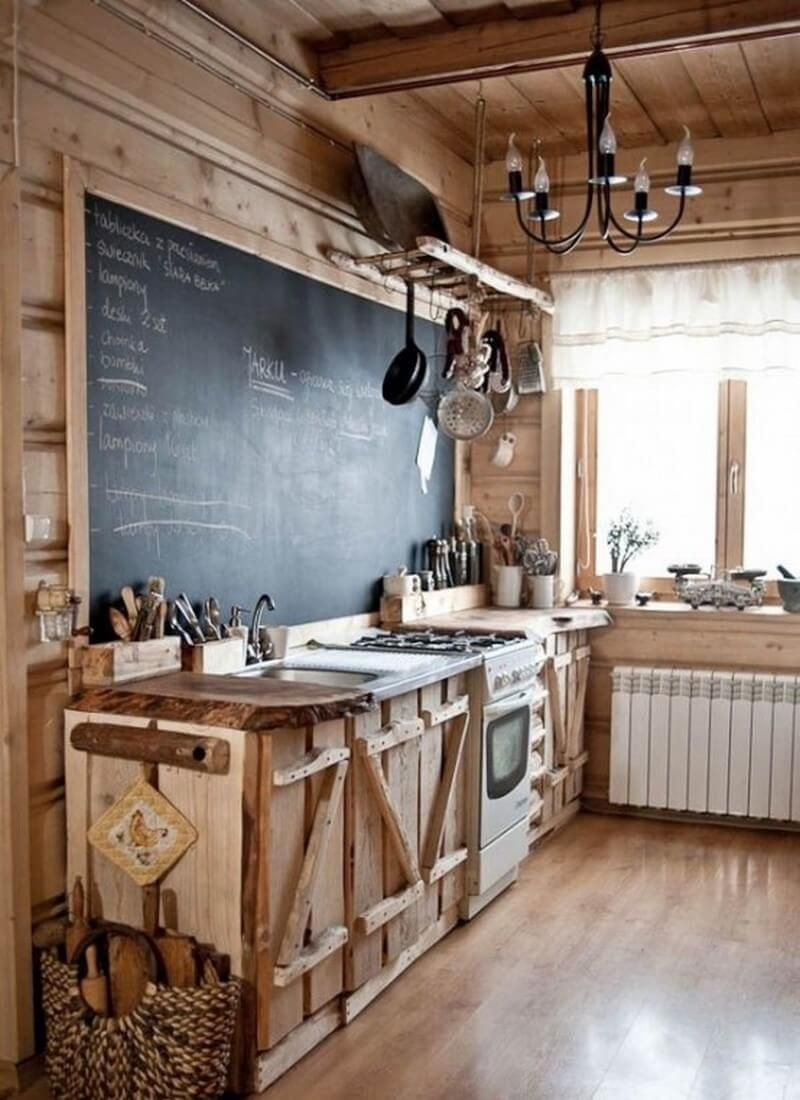 A chalkboard makes a unique addition to a cabin style rustic kitchen