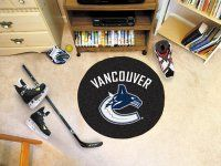 Vancouver Canucks Hockey Puck Mat. $22.99 Only.