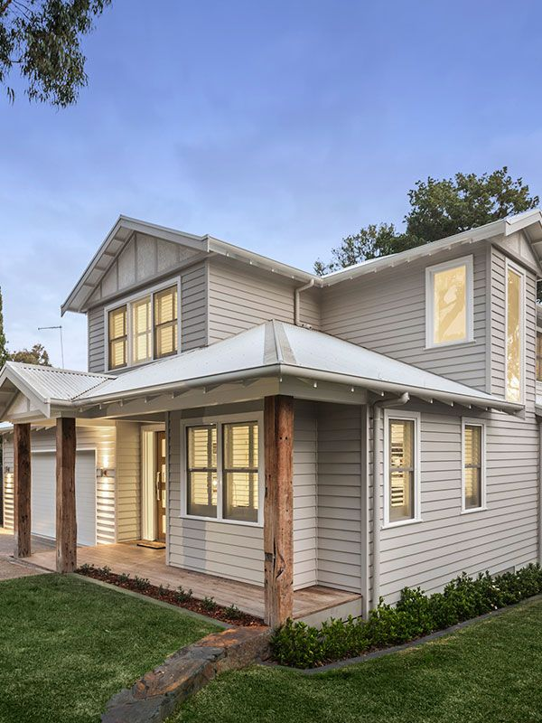 Set on a sloping block in tree lined blackburn this - Modern weatherboard home designs ...