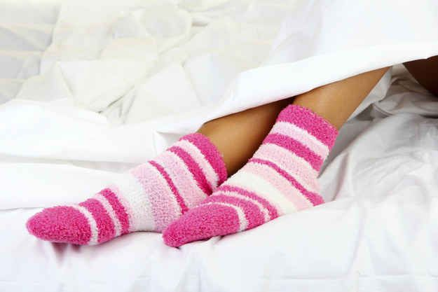 Wear a pair of warm socks if you're too cold, or stick your feet out of the duvet if you're hot.