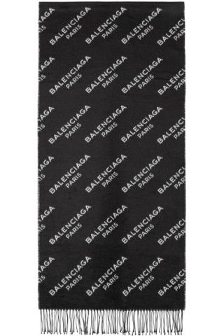 4d1ff2ccc Rectangular silk scarf in black featuring logo pattern knit in white  throughout. Fringed trim at ends. Tonal stitching. Approx. 78 length x  18.75 height.