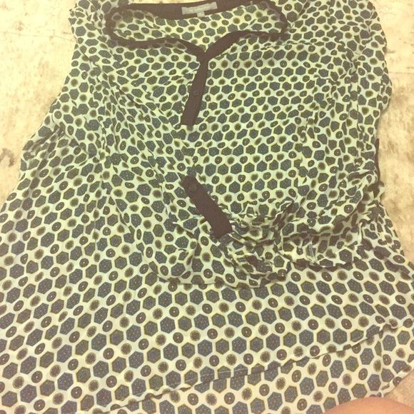 Patterned blouse Patterned blouse is greenish blue, with white all over. Black buttons to adjust around neckline. 3/4 sleeve. Chiffon like material. My Collection  Tops Button Down Shirts